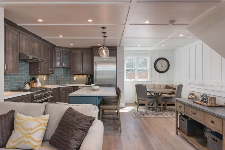 The kitchen features dark wood cabinets and a Thermador fridge and freezer.