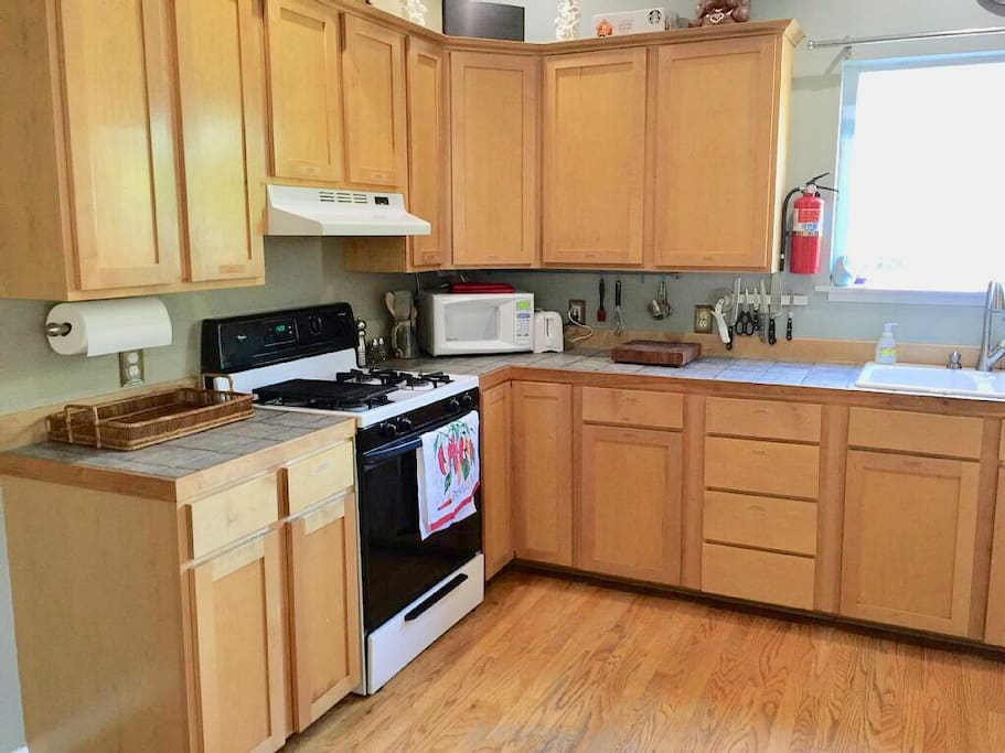 We provide cooking and serving dishes and utensils, as well as a lighter wand for lighting the gas stove.