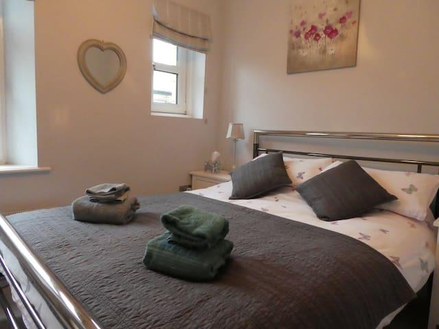 Double bed in the first floor bedroom.