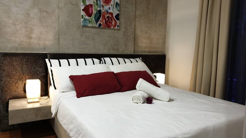 Master bedroom with queen size bed and comfy pillows
