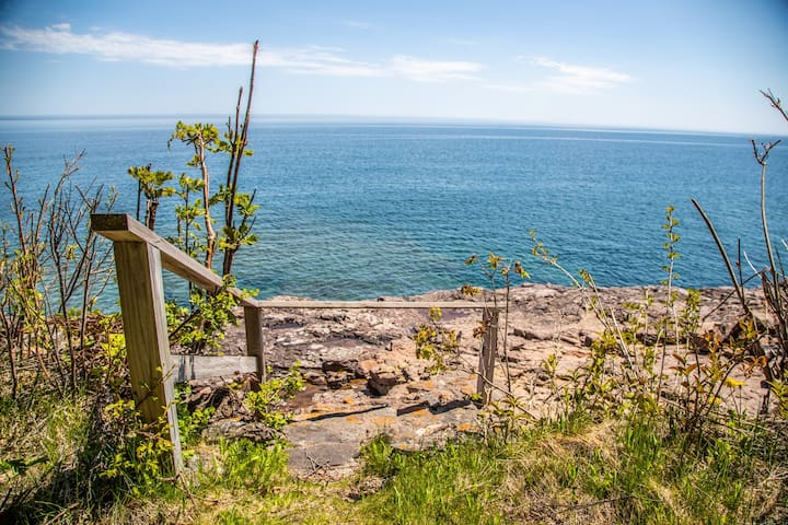 Take an easy stroll down to the private ledge rock Lake Superior beach.