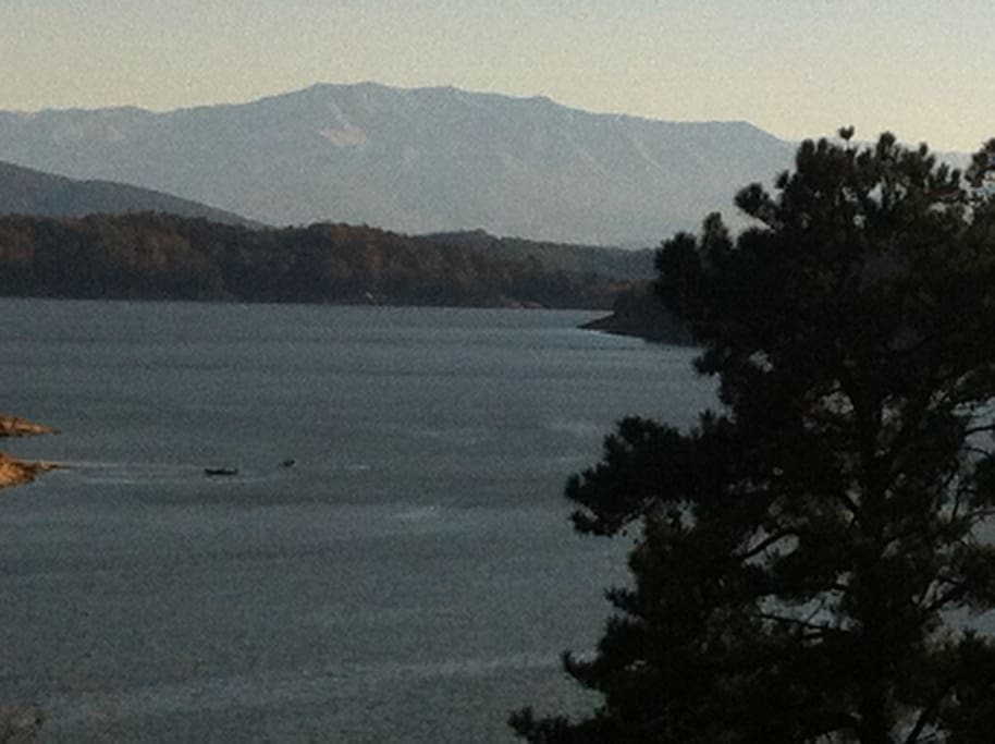 view of snow cap mountains from the master bedroom deck