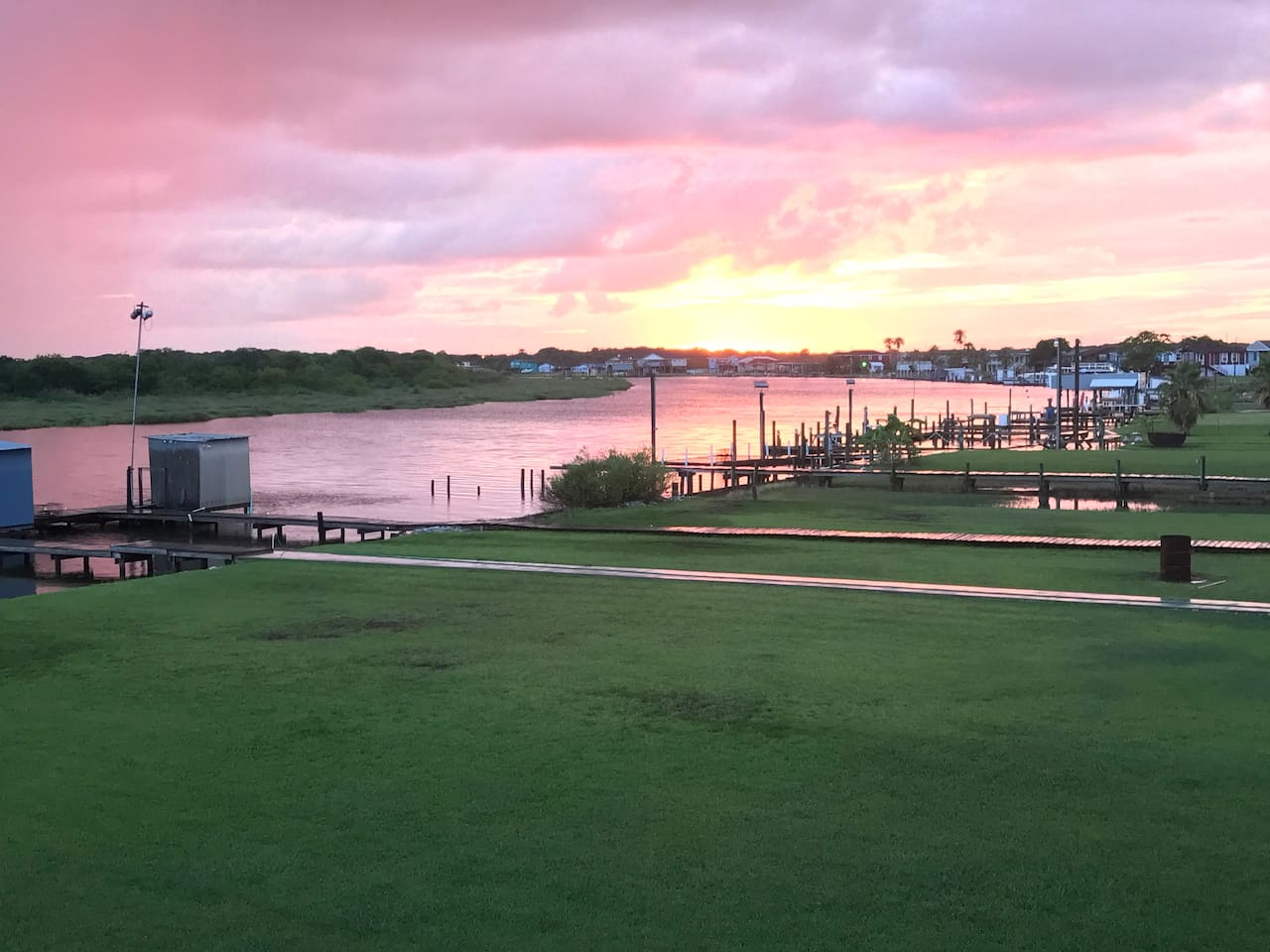 Beautiful sunset pic taken from the upstairs deck at Nauti Dreams! You'll also be able to experience magical sunsets like this during your stay at Nauti Dreams!