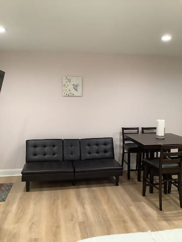 Twin-size sofa-bed and dining room