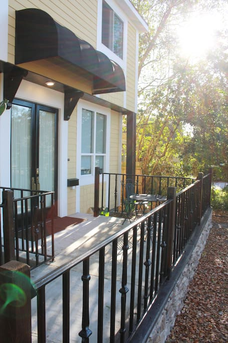 Enjoy stepping out to a morning coffee, or an evening out with a glass of wine (or both!) on your private porch.