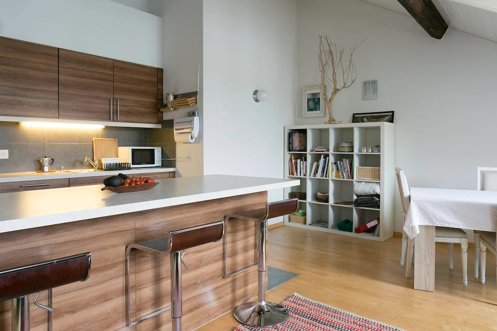 Spacious kitchen, dining area and living room