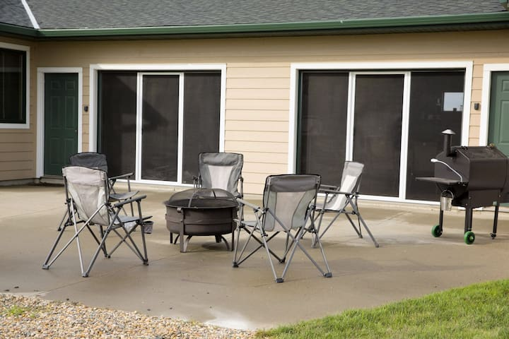 Front Patio with firepit and Screened-in Man Caves