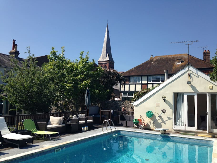 Pool, diving board and a view of the beautiful church spire