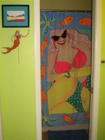 Master bath with hand painted shower curtain