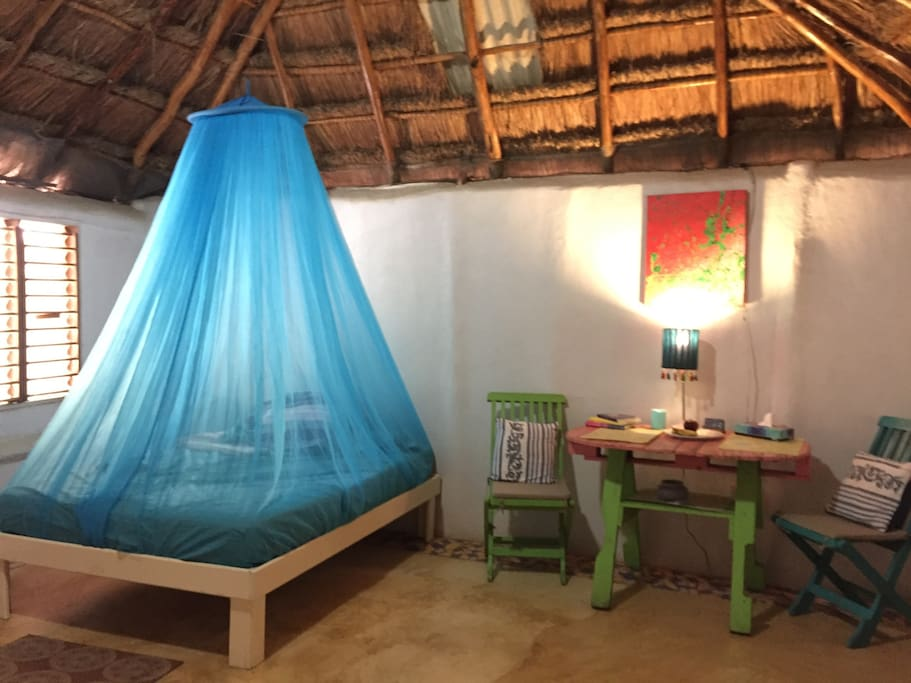 Cabin has two beds: one double and one single with mosquito netting