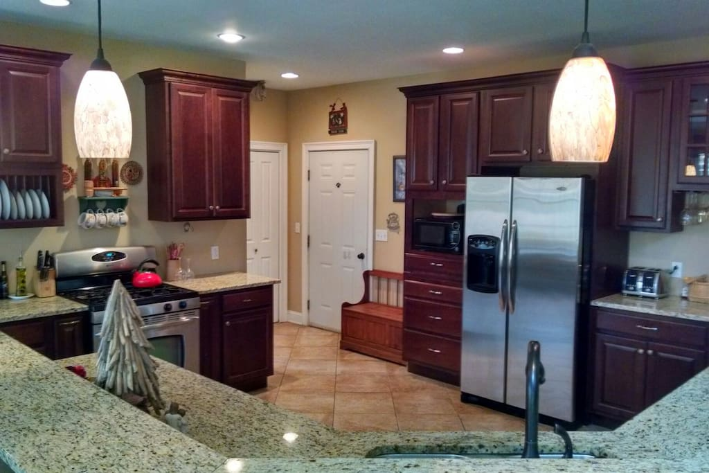Large open style kitchen for your cooking endeavors.  Appointed with a plethora of cookware.