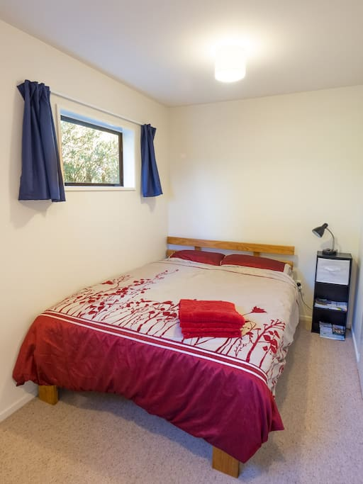 A warm and comfy double bedroom for you.