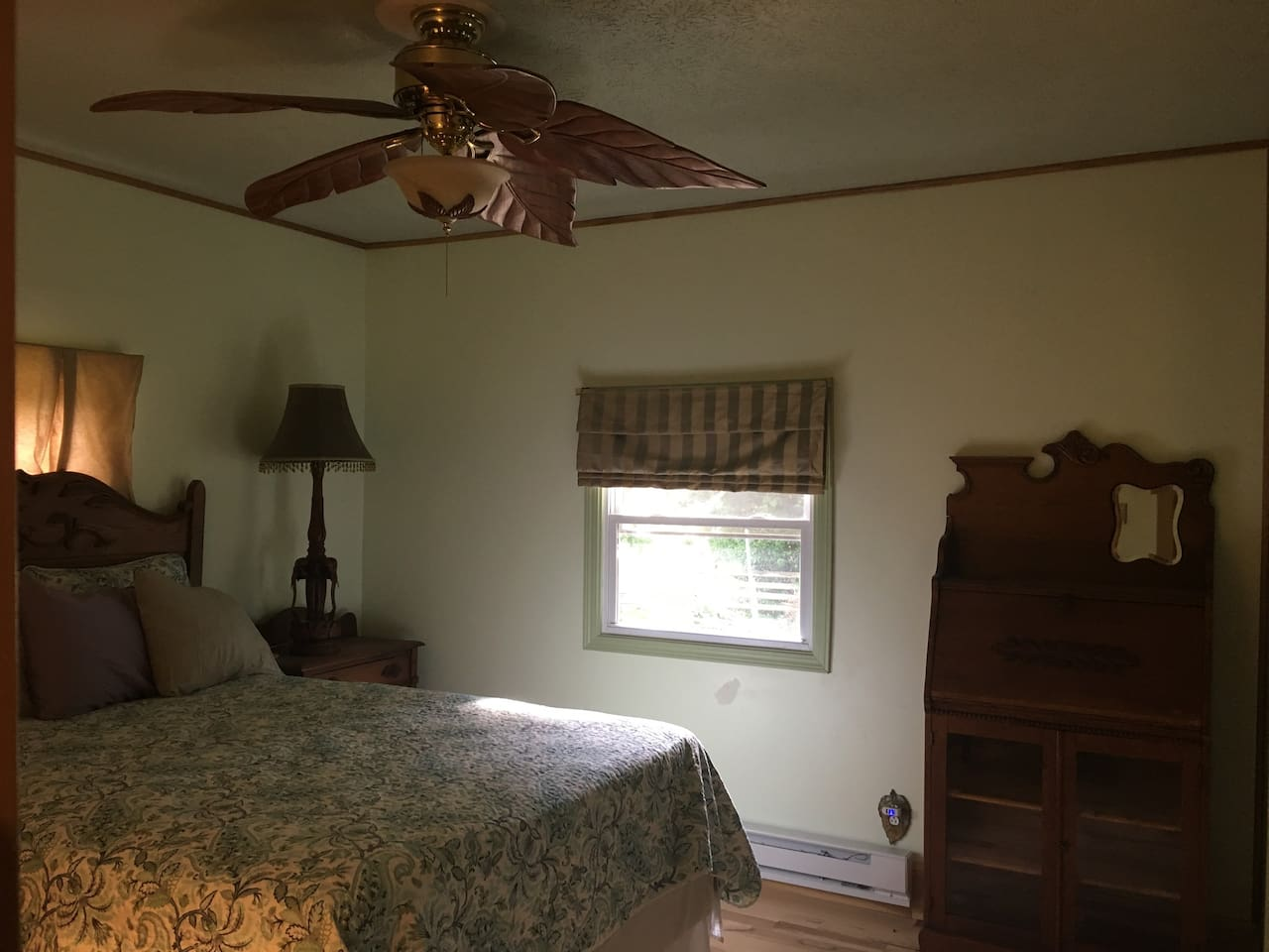 Dogwood Room.  Furnished in turn-of-last-century antiques with a Larkin desk, wood blade ceiling fan and solid oak furniture.