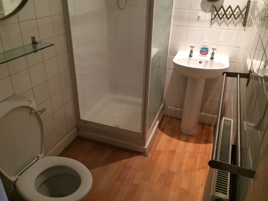 Bathroom with electric shower.