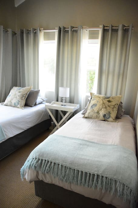 The 2nd bedroom has two comfortable hotel quality single beds with plenty cupboard space.