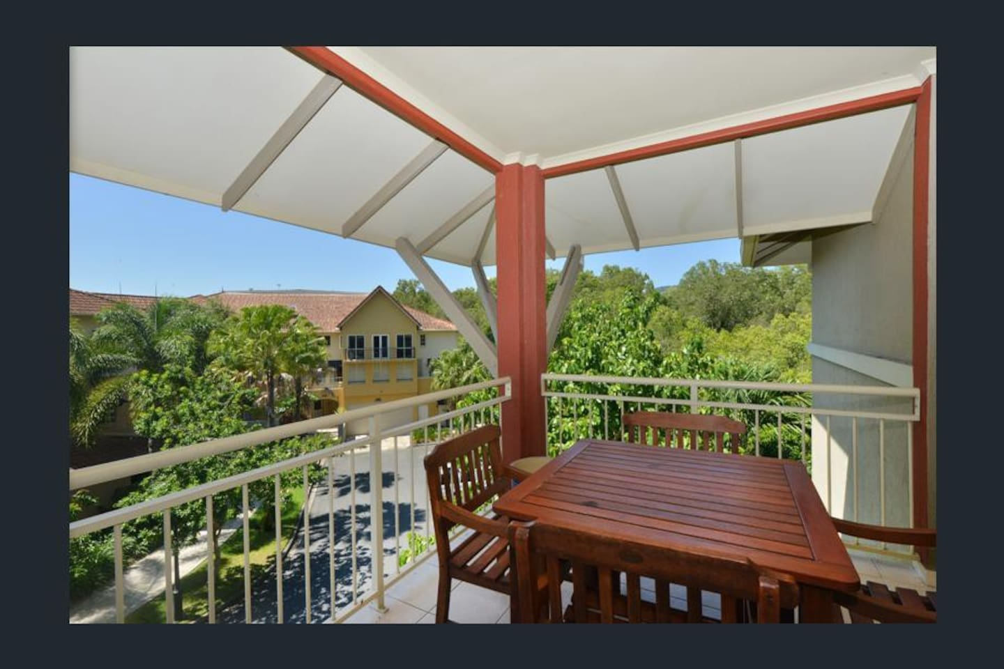 Enjoy a wine overlooking the greenery from the deck
