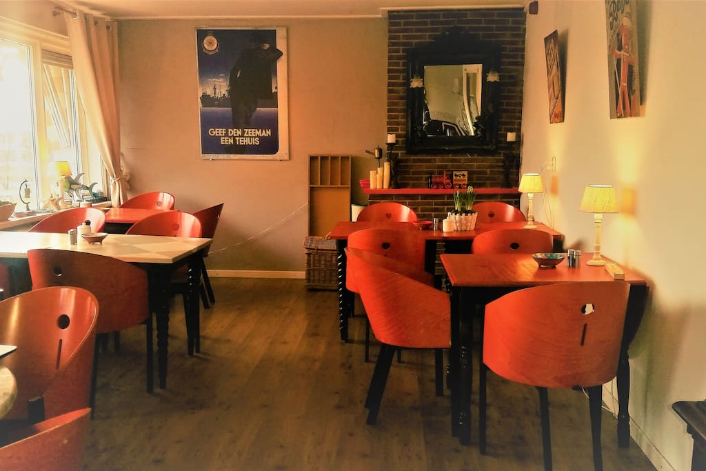 This is the living. Here we serve breakfast (between 8.00-10.00). Also we have free coffee & tea and a fully stocked fridge in case you would like a beverage. Would you prefer to eat in your room or on the terrace ... no problem!