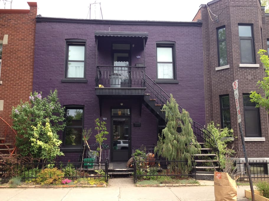 The apartment is on the ground floor of this purple 1920's house : )