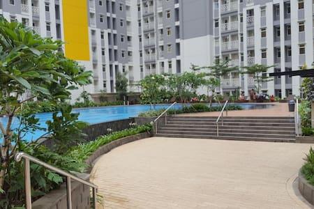 Apartment SUMMARECON BEKASI SPRING LAKE 2BR - B