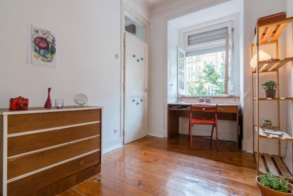 Sunny bedroom, wooden floor, lovely atmosphere.