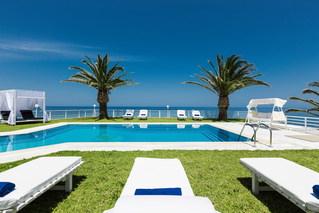 70 sq. m swimming pool with sun beds, umbrellas, swings and gazebo beds