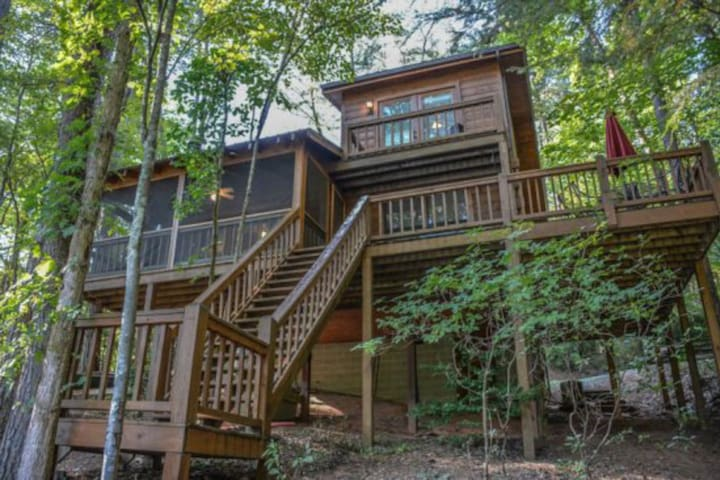 Charming, waterfront cabin w/ a private hot tub, lakeside firepit, & dock!
