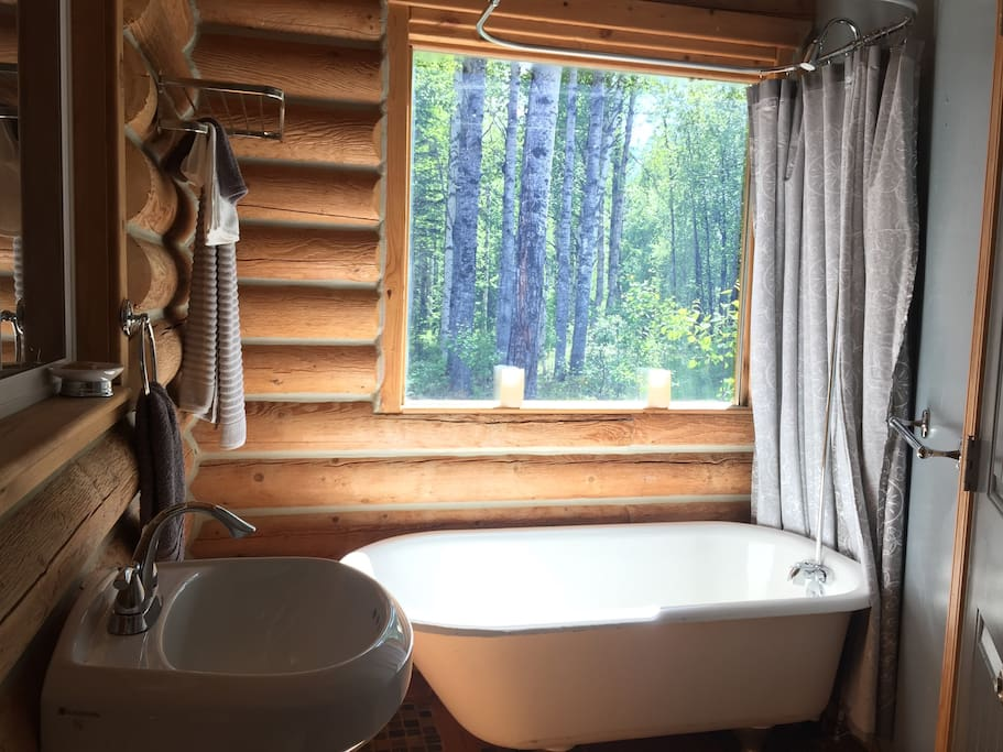 Your private indoor bathroom includes antique claw foot tub, pedestal sink, toilet, fan, hair dryer, soap, shampoo, and luxury towels.