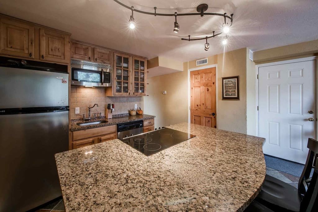 The kitchen also features a large granite island, which is great for entertaining and seconds as a dining area with seating for up to five (5) people.