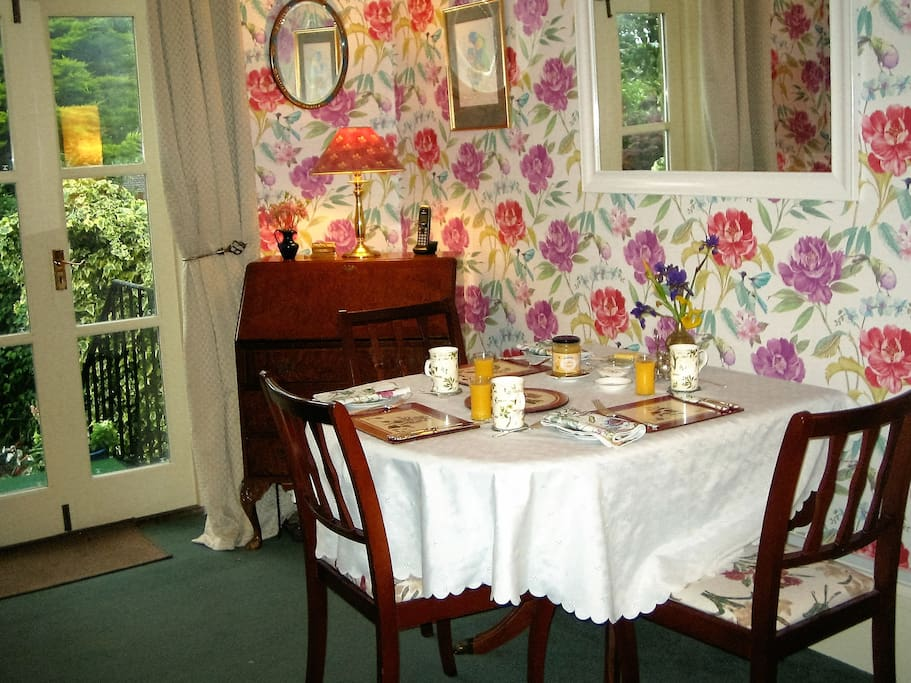 Dining room with french windows to the garden.