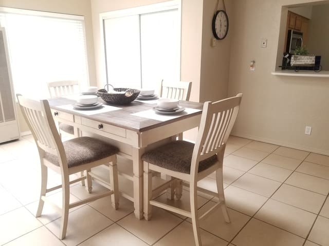 Kitchen table that can very comfortably seat four.