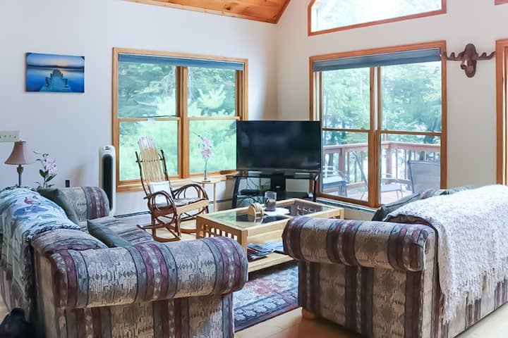 Beautiful, waterfront home w/ a dock, furnished deck, gas grill, & lake views!
