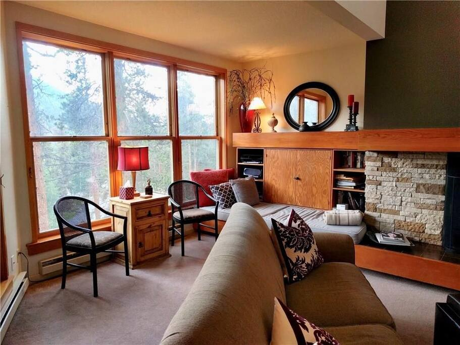 Living room reading nook and large windows
