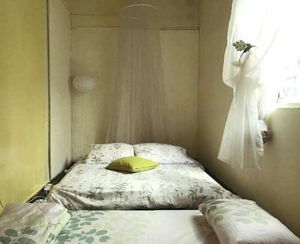Second bedroom with a queen- sized mattress plus additional single.