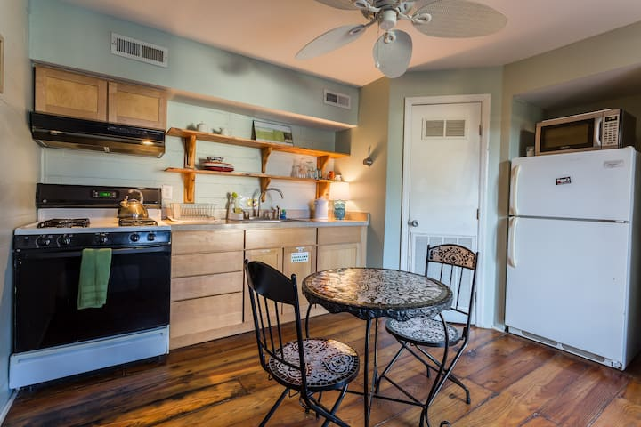 Shared fully stocked kitchen where you can cook or store food while you are traveling.
