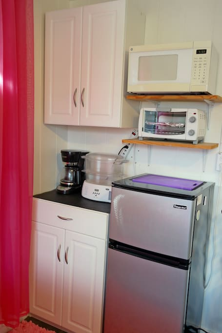 Ensuite Kitchenette (coffee maker, steamer, oven, microwave, refrigerator, 2 burner cooktop, dishes, pots and pans, and more)