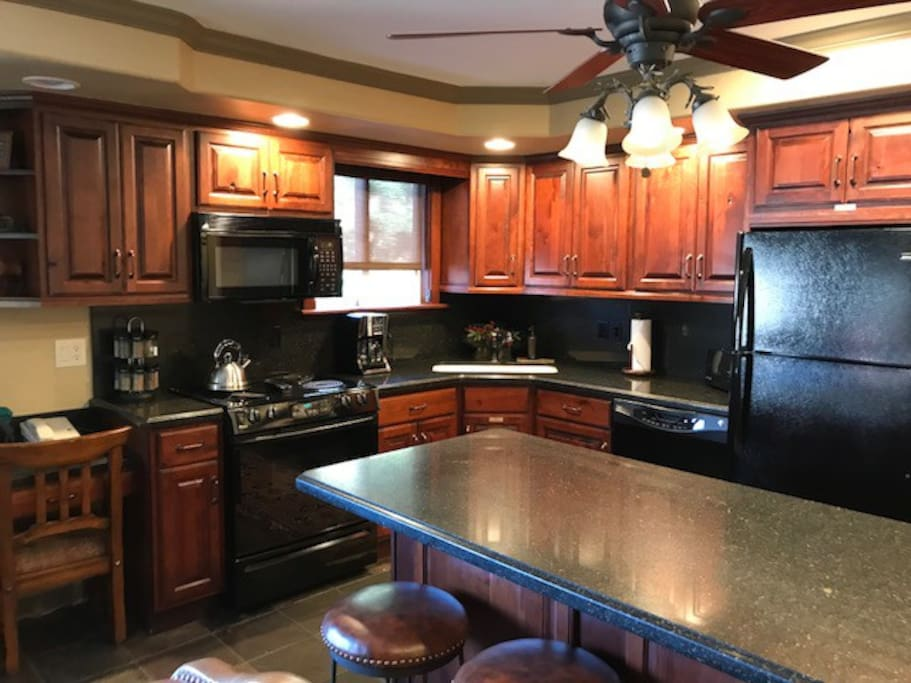 Our updated kitchen with granite counters and fine finishes.