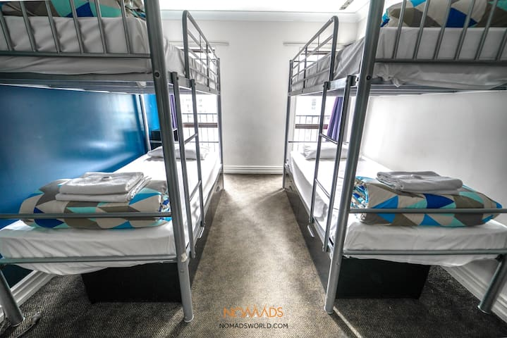 Comfortable bed in a 4 bedroom mixed en-suite dormitory - Prime CBD location