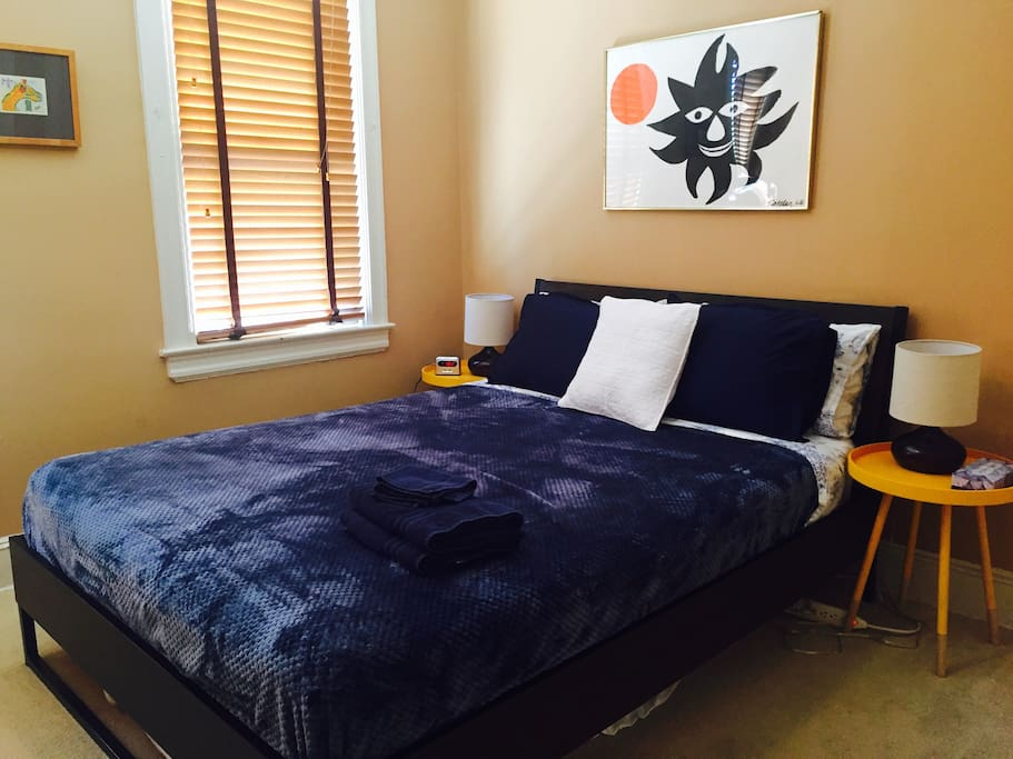 Master bedroom with queen size bed (provides complimentary items -- sheets, blankets, garment steamer, hair dryer, towels, shampoo, and soap)