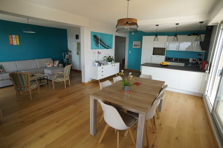 Living and dining room with open kitchen