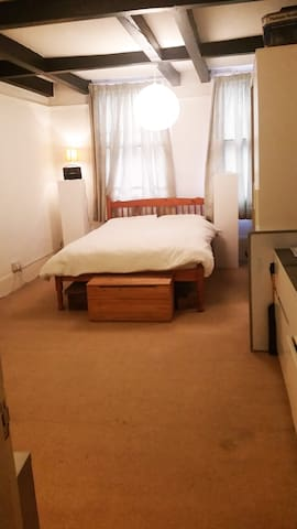 Large private bedroom with double bed and a single