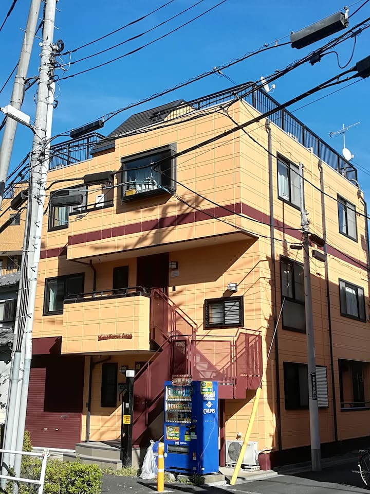 Front view of house, entrance to 1F is private. House is 8 mins from Aoto station which has direct access from Narita and Haneda Airport. Nearby supermarkets and restaurants are value for money. Convenient store and 100 Yen Daiso Store within 15mins.