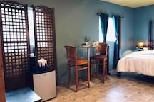 Room includes Kerug machine and mini fridge for snacks. Bistro cocktail table is perfect for morning breakfast on the farm.