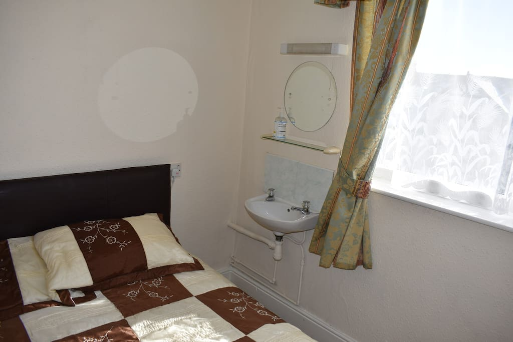 double bed with wash basin
