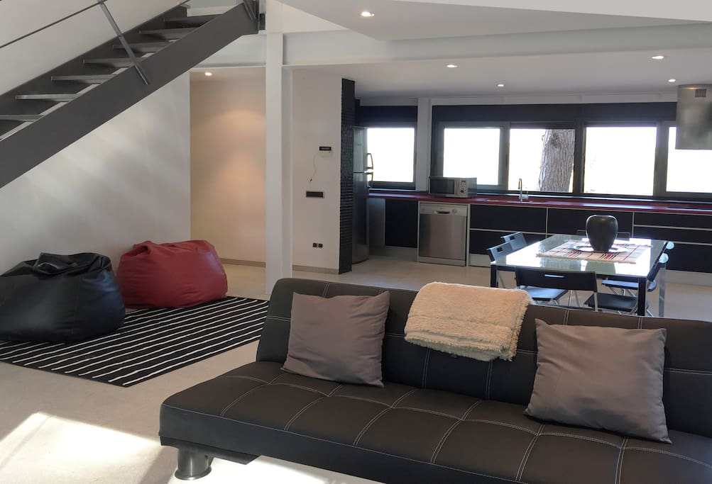 Lounge, Dining room and kitchen by private terrace with pool. 2 sofa-beds (large twin).  Bathroom with shower.