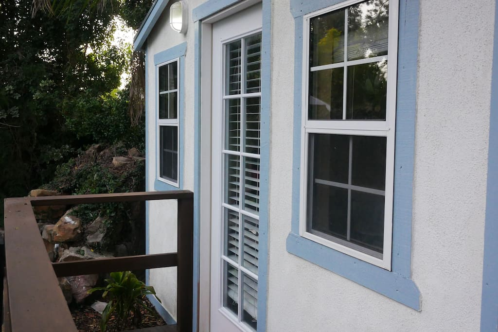Bungalow deck entrance with code on door for extra security
