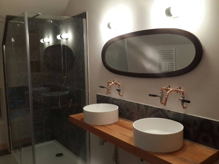 Large walk in shower and double basins