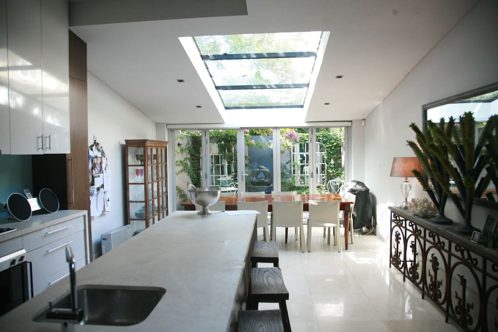 Massive kitchen and dining area that spills out onto a private leafy courtyard.