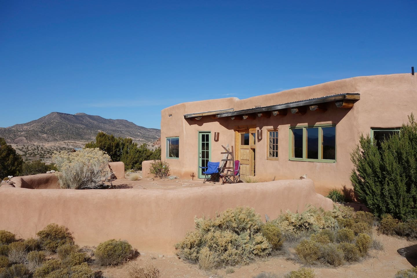 This is a sweet adobe home with plenty of outdoor space to enjoy the expansive views.