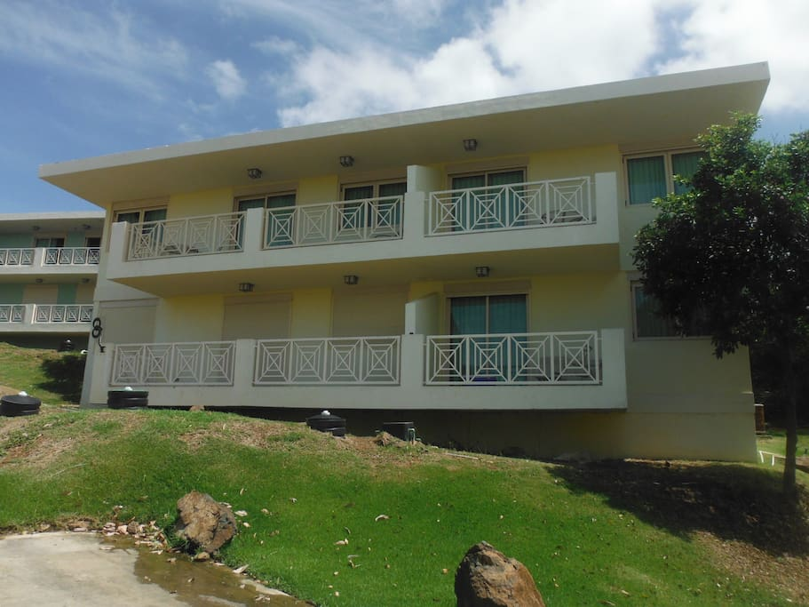 This Villa is 4 units. Each with a private balcony. One bedroom VIlla is the left side bottom Floor unit.