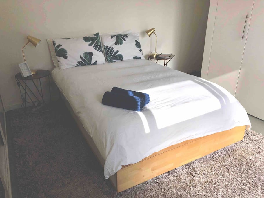 Double bed with bed lamps.